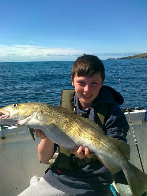 12-year-aold-Eamonn-Cooke-with_a_fine_cod_from_Aughrus_Bay.jpg