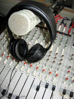450799-radio-studio-detail-microphone-headphones-and-mixer.jpg