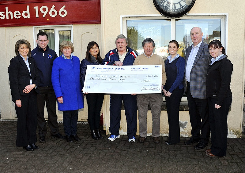 CU_cheque_to_social_services_FEB_7237.jpg