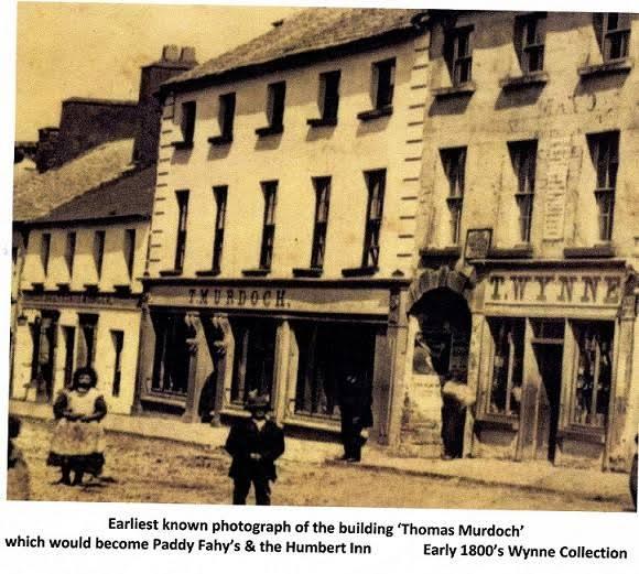 Earliest_known_photo_of_Humbert_Faheys_Building_pre_1865.jpg