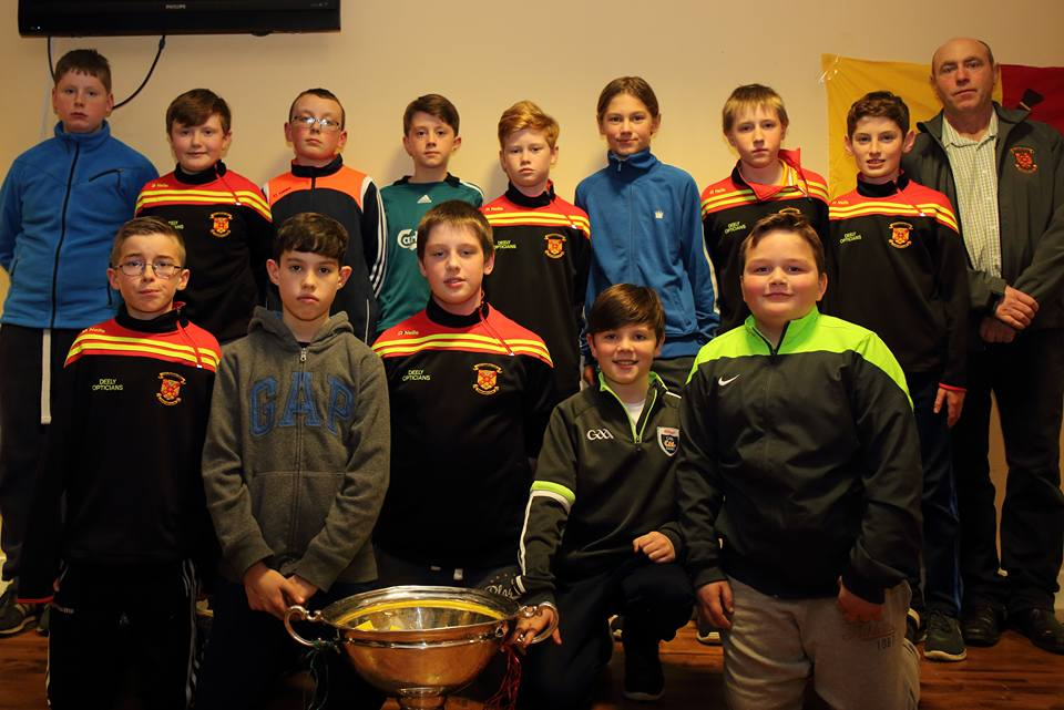 u12_county_champions_coach_Martin_O_Donnell_and_the_nicky_rackard_cup_at_presenatation_night_2016.jpg