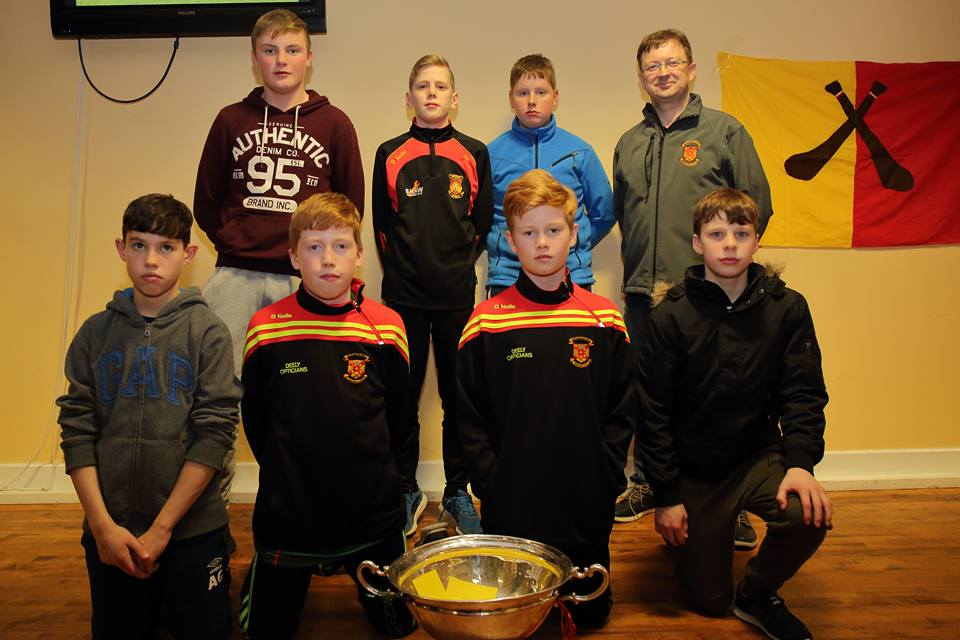 u13_county_champions_hurlers_with_coach_Aiden_O_Shea_and_the_nicky_rackard_cup_at_presenatation_night_2016.jpg