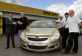 Ken Wright has a photo of the latest winner of a car in the Credit Union Members Draw. Click on photo for an enlargement.
