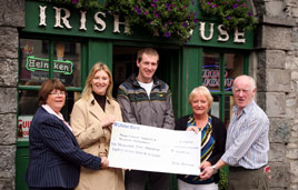 Eoin Heverin shorn of his dreadlocks presenting a cheque for over 10,000 to Mayo Cancer Support and Western Alzheimers. Click on photo for the details.