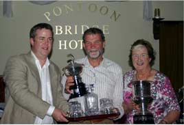 John and Ann Geary present the top prize for their annual end of season fishing competition held on Saturday 25th. Click on photo for more.