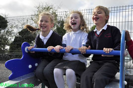 Alison Laredo has photos taken at the opening of the new playground at