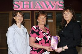 Ken Wright photographed Marian Monaghan winner of a prize bond voucher at Shaws. Click on photo for details.