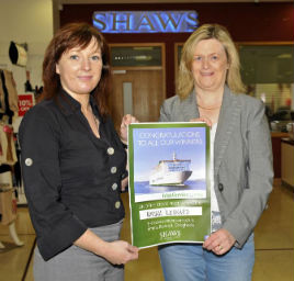 Miriam Leonard picks up her prize at Shaws. Click on photo for the details from Ken Wright.