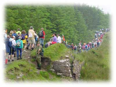 Walkers crossing the bridge at Burren Castlebar on the Four Days Walks Mayo Ireland