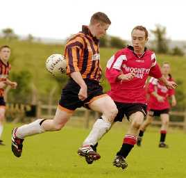 Niall McNulty, Straide and Foxford United and Maurice Welsh, Ballinrobe Town at Milebush, Castlebar, Co. Mayo, Summer 2000.<br> Photo: Keith Heneghan / Phocus