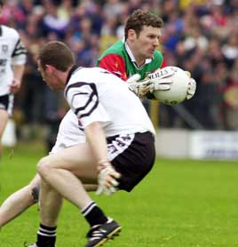 David Nestor of Mayo passes his Sligo opponent during the Connaught Championship match, Summer 2000. <br>Photo: Keith Heneghan / Phocus.