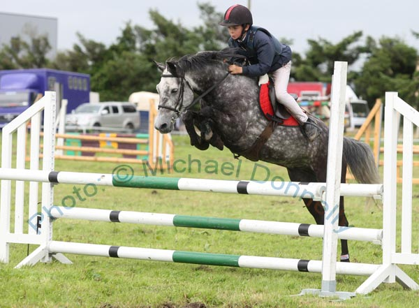 Cormac Hanley Jnr, Claremorris, on Emerald Pride clears the final jump to win the 138 ABC  Claremorris Show Jumping section at Claremorris Agricultural Show. Photo: © Michael Donnelly