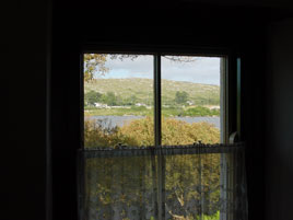 looking out the window of Pearses Cottage